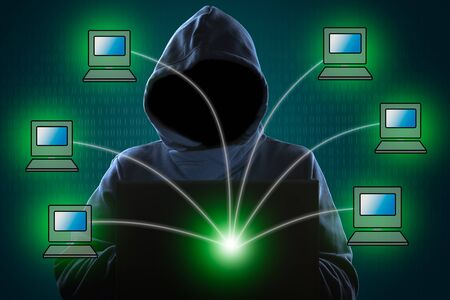 Faceless hooded anonymous computer-network hacker with programming digital code in background, Computer network hacker concept