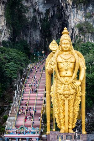 buddha statue: Batu Caves statue and entrance near Kuala Lumpur, Malaysia Stock Photo