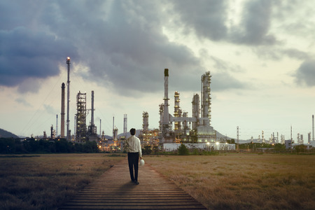 Engineer standing at Oil refinery, Power and energy crisis concept photo