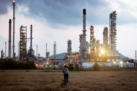Engineer standing at Oil refinery photo