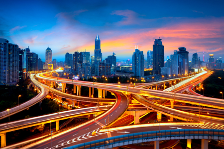 Shanghai elevated road junction and interchange overpass at night, Shanghai China Foto de archivo