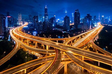 Shanghai elevated road junction and interchange overpass at night, Shanghai China Stock fotó