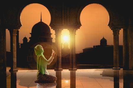 muslim pray: Female muslim praying in mosque during sunrise time mosque during sunrise time Stock Photo
