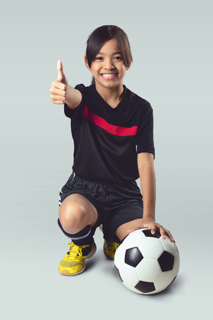young asian: Young asian girl holding soccer ball, Isolated over white