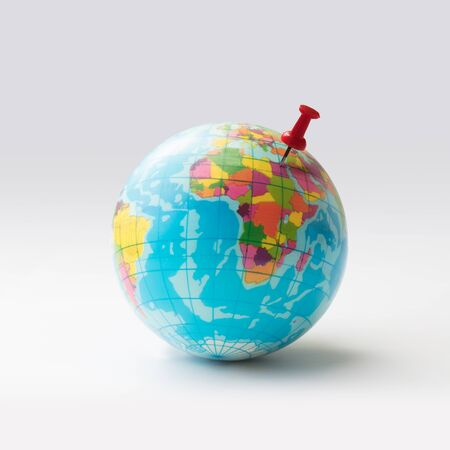 thumbtacked: Red pin on globe, Isolated over white Stock Photo