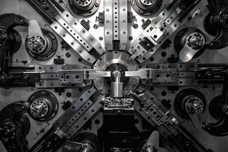 tool and die: Operator machining automotive part by turning machine, Industry machine background