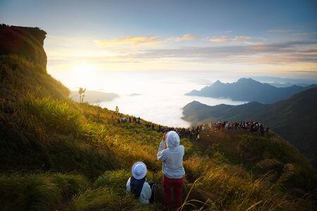 Tourist see sunrise at Phu chi fa in Chiang rai, Thailand photo