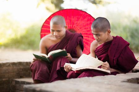 buddhist monk: Young buddhist novice monk reading and study outside monastery, Bagan Myanmar