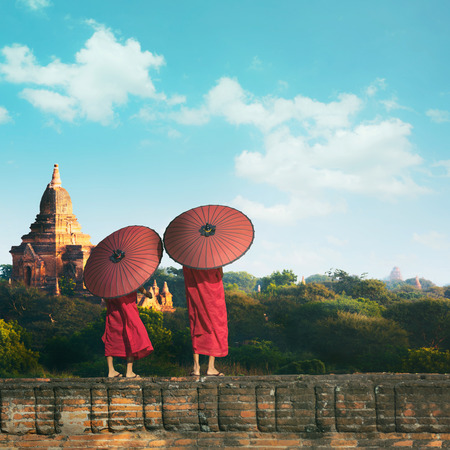 Monk standing with holding umbrella, Bagan Mandalay Myanmar