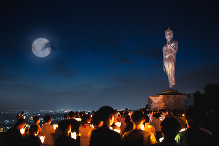On Magha Puja Day, there is traditionally lighting of candle, circumambulation and meditation to pay homage to the Lord Buddha. Stock Photo