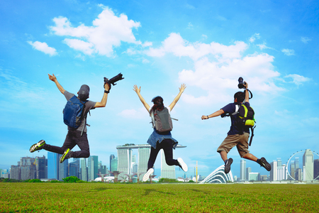 Tourism travel people leisure and senior concept group of happy friends photo