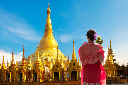 Young woman standing at Shwedagon pagoda, Yangon Myanmar