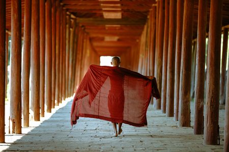 Little monk walking at old temple, Salay Bagan Myanmar Stock Photo