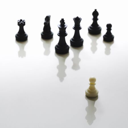 battleground: Single pawn against many enemies as a symbol of difficult unequal fight or struggle of minorities, Business stategy concept