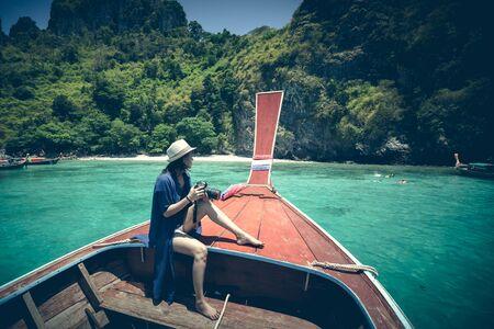 Happy female traveling on boat, Krabi Thailand photo