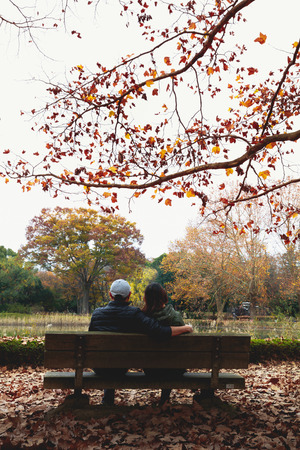 Couple in the garden of Memorial Park at fall, Tokyo Japan photo