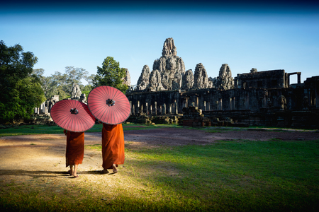 Ancient stone faces of Bayon temple, Angkor wat Siam Reap Cambodia