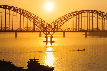 Yadanarbon bridge at sunset, Irrawaddy River, Mandalay Myanma
