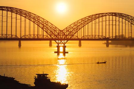 Yadanarbon bridge at sunset, Irrawaddy River, Mandalay Myanma