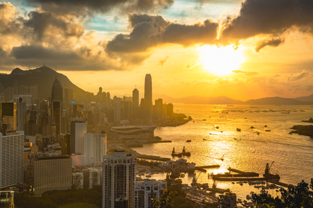 Hong Kong city skyline, Hong Kong sunset from Braemar hill a destination viewpoint to observe Victoria Harbour, Hong Kong Фото со стока