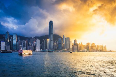 Victoria harbour at sunset, Hong Kong skyline Фото со стока