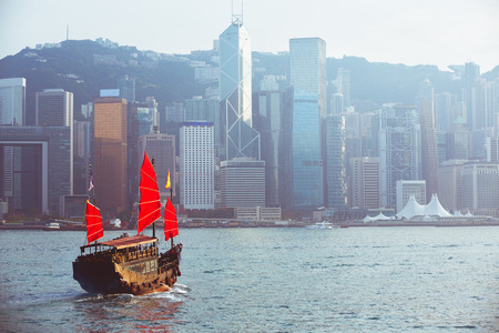 Duk ling ride Hong kong harbour with tourist junk, Hong kong China, Vintage colour tone Фото со стока