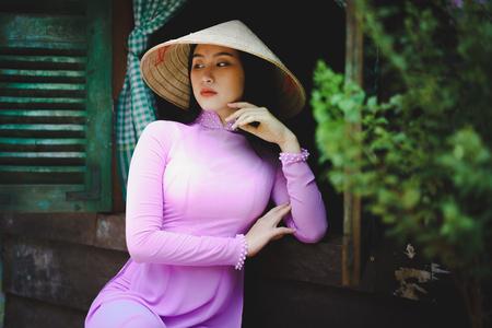 Beautiful vietnamese woman in Ao Dai traditional dress of Vietnam, Ho Chi Minh city Vietnam