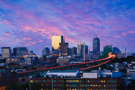 Boston city skyline with bridges and highways at dusk, Boston Massachusetts USA Фото со стока