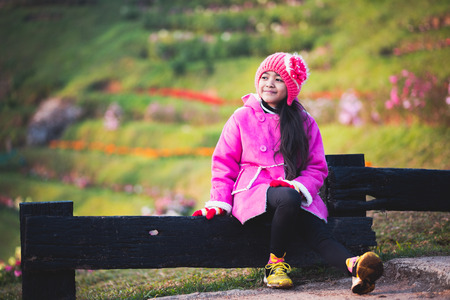 Little girl wearing clothes in winter day, Outdoor portrait