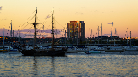 Sailboat anchored in the Boston harbor, Boston Massachusetts USA Фото со стока