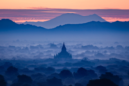 Beautiful scenery during sunrise at the pagoda of Bagan, Myanmar Фото со стока