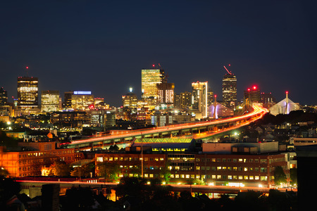 Boston city skyline with Boston bridges and highways at dusk, Boston Massachusetts USA