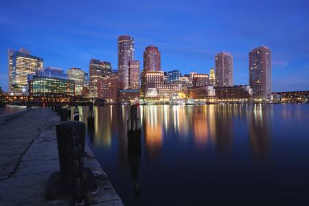 Boston harbor at dusk in Boston Massachusetts USA Фото со стока