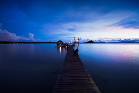 Wooden bridge at dusk Koh Mak, Trat Thailand Фото со стока - 123930067