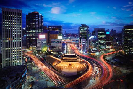 Sungnyemun Gate or Namdaemun Gate at Namdaemun market with light trails of car at night in Seoul, South Korea