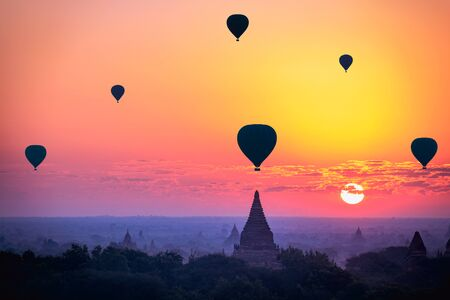 Hot air balloon over plain of bagan in misty morning, Mandalay Myanmar