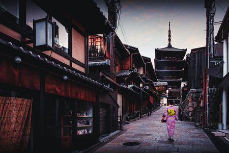 Asian woman wearing japanese traditional kimono at Yasaka Pagoda and Sannen Zaka Street in Kyoto, Japan Standard-Bild - 131380659