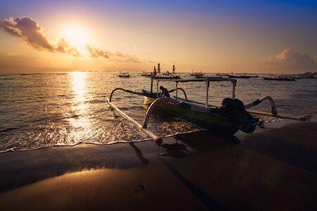 Traditional Balinese ships Jukung at sunrise, Matahari beach Indonesia