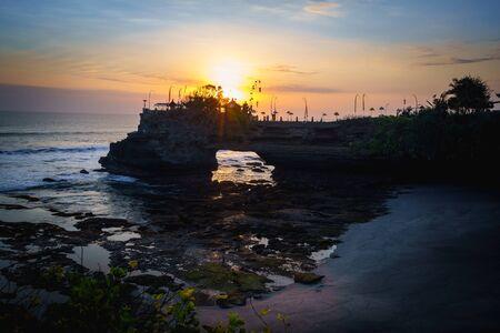 Batu Bolong Temple at sunset, Bali Indonesia