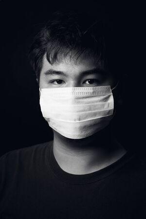 Asian teenage medical face mask, studio portrait