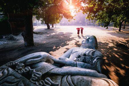 The forgotten buddha, Buddha statue laying on the ground, Mandalay Myanmar