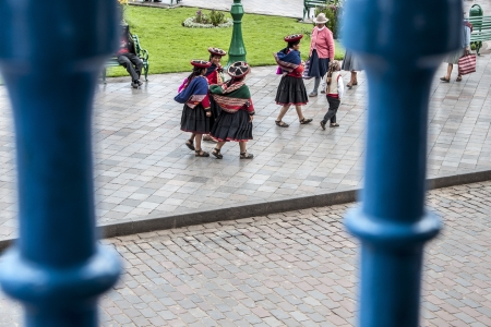 Cuzco, Peru -March 8, 2013: A view of Quechua women from a cafe balcony walking and socializing through the main square Plaza de Armas in Cuzco, Peru.