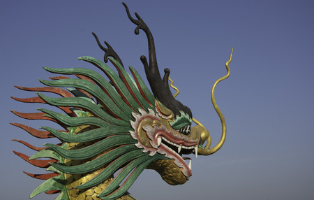 heads old building facade: Dragon head sculpture on the temple stairs Stock Photo