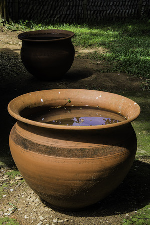 ceramicist: Earthenware old clay pots with water Stock Photo