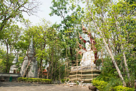 reconstruct: Reconstruct buddha statue, Wooden scaffolding for construction Buddha statue, in the temple, Thailand.