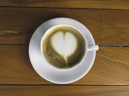 cappucino: A cup of cappucino on a wood background Stock Photo