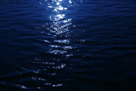 Close up of a moonlight reflected on the sea, romantic night