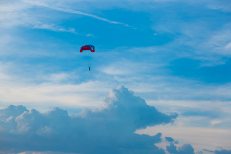 Skydiver on colorful parasailing in blue sky  over the sea at pattaya thailand
