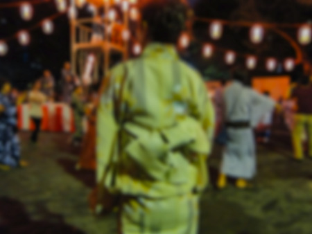 blurred a woman wearing kimono who ready to OBON dance festival background in summer, Japan Фото со стока