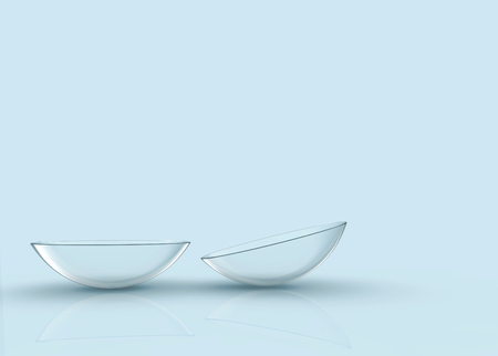 3d rendering. Thin clear contact lens on light blue background.